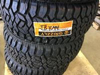 (4) Grizzly 33X12.5X 20 Tires (new)